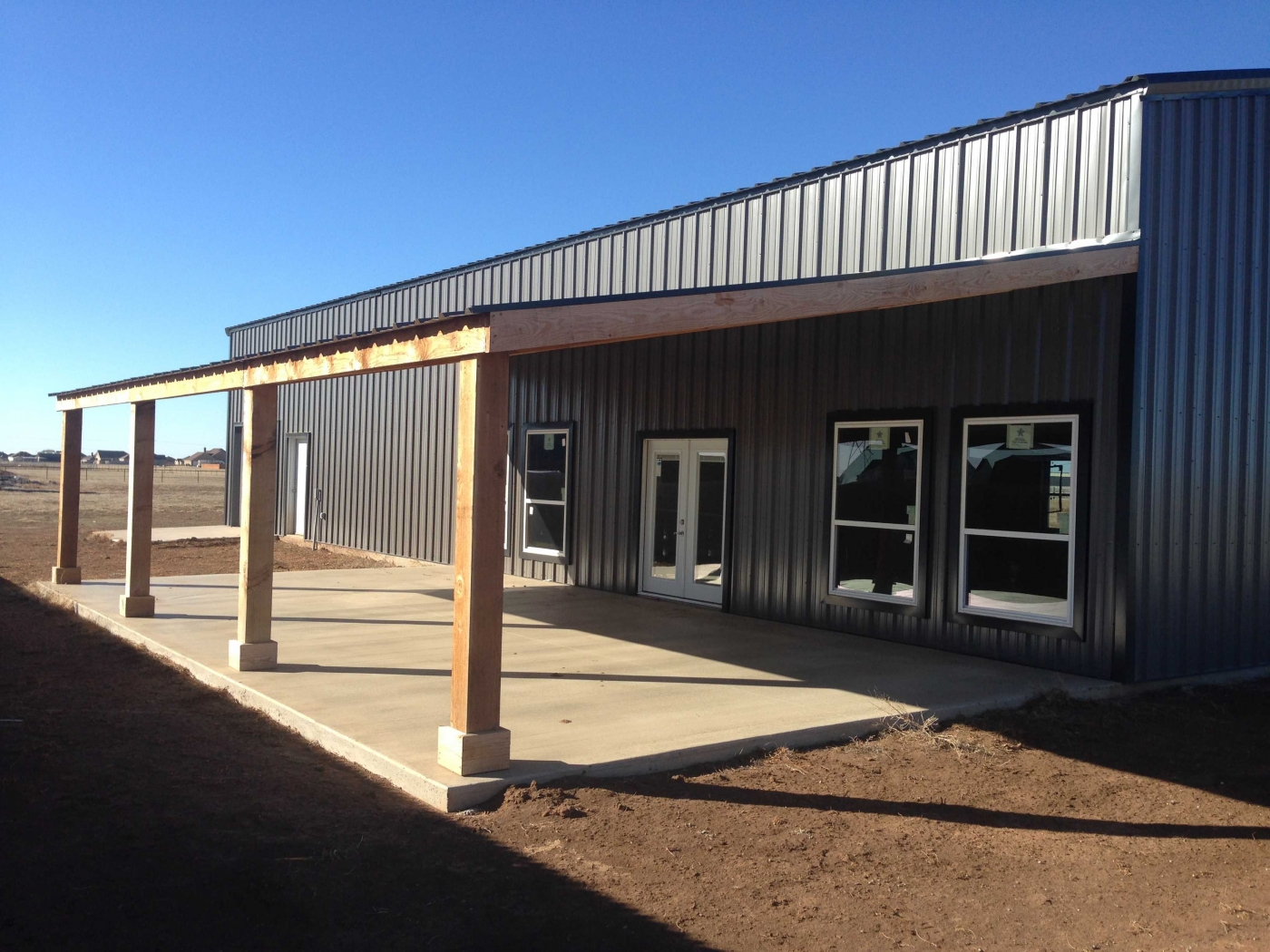 Shop apartment with porch custom barns and construction for Metal building apartments
